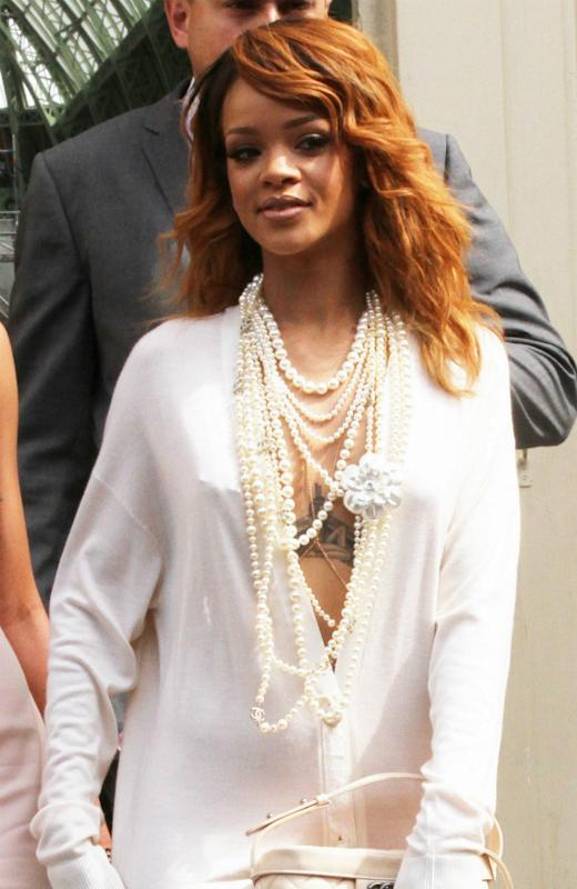 Rihanna Strips Down To Thong And Dominatrix-Style Prada Boots In New Photo
