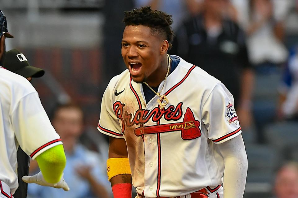 ATLANTA, GA  APRIL 28:  Atlanta right fielder Ronald Acuna Jr. (13) reacts after scoring a run during the MLB game between the Chicago Cubs and the Atlanta Braves on April 28th, 2021 at Truist Park in Atlanta, GA. (Photo by Rich von Biberstein/Icon Sportswire via Getty Images)