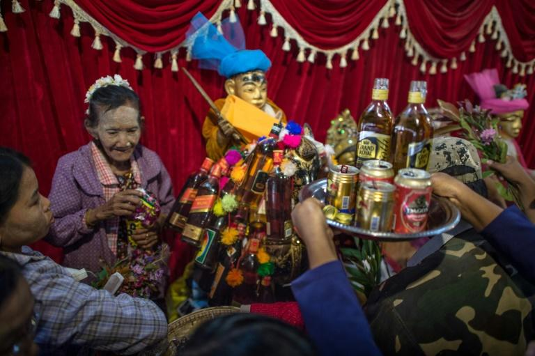 The alcohol-fuelled festival attracts thousands of devotees to a small village southwest of Mandalay, Myanmar