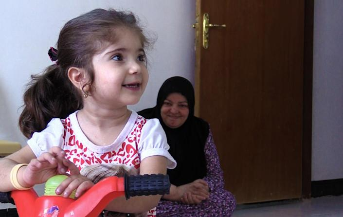 Noor Muhammed Katim, 3, was born with congenital heart disease, causing discoloration to her limbs and face. After several surgeries, she still struggles. Her family does its best to keep her stable. (Photo: Ash Gallagher for Yahoo News)