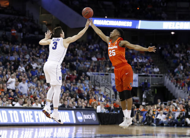 Duke's Grayson Allen (3) and Syracuse's Tyus Battle (25) reach for the ball during the first half of a regional semifinal game in the NCAA men's college basketball tournament Friday, March 23, 2018, in Omaha, Neb. (AP Photo/Nati Harnik)