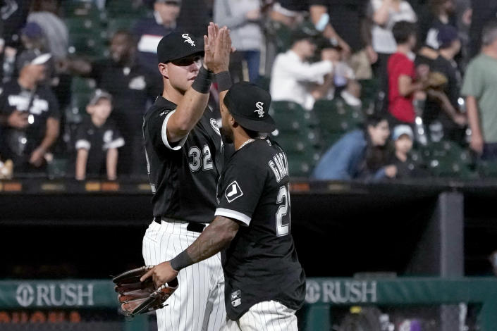Chicago White Sox's Gavin Sheets (32) and Leury Garcia celebrate the team's 9-3 win over the Los Angeles Angels in a baseball game Tuesday, Sept. 14, 2021, in Chicago. (AP Photo/Charles Rex Arbogast)