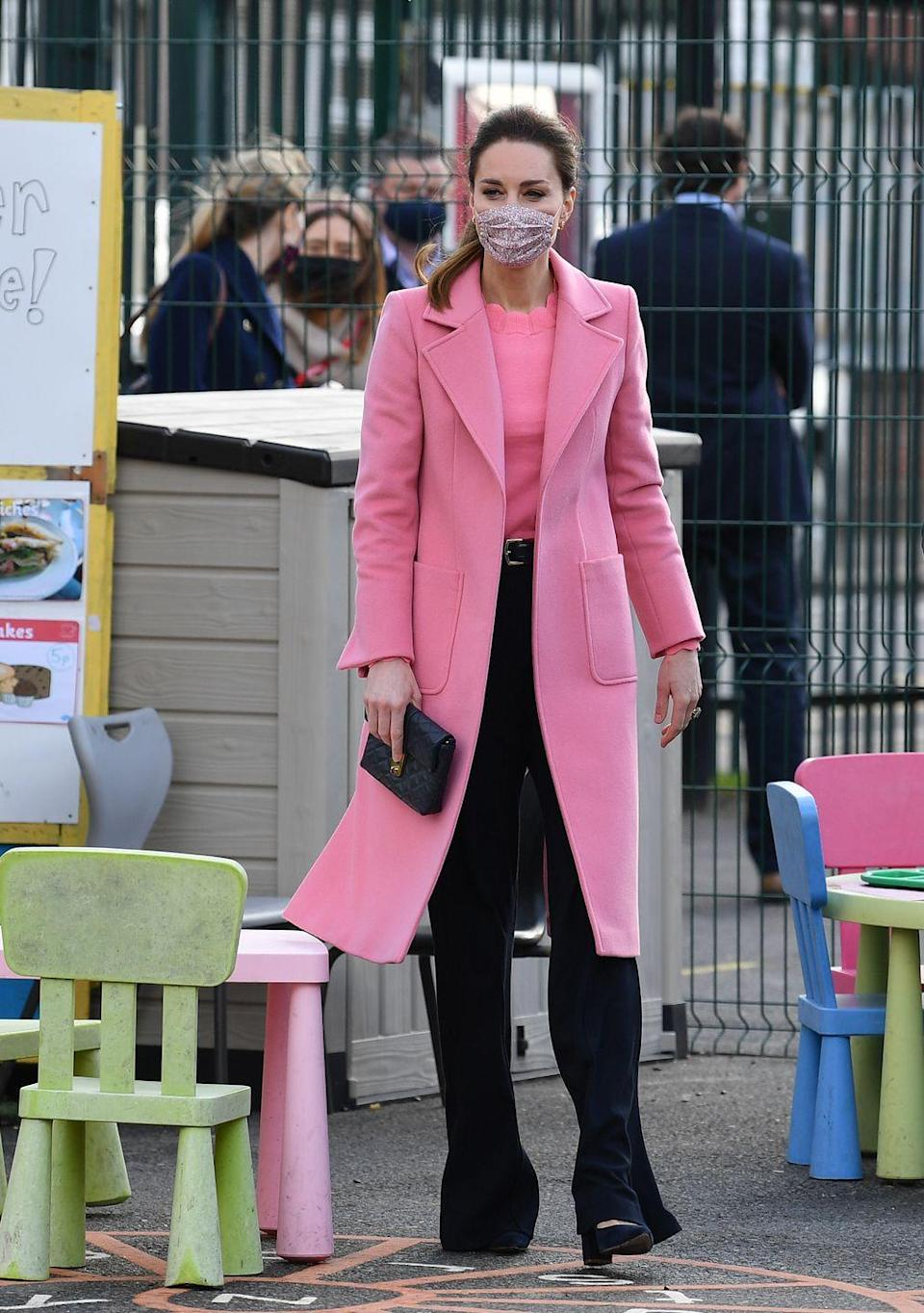 """<p>Kate sported a matching pink knit top and coat with pointed-toe block heels while celebrating the reopening of an east London school that closed due to COVID-19 restrictions. It was at this event that William and Kate spoke about Harry and Meghan's interview with Oprah, making them <a href=""""https://www.townandcountrymag.com/society/tradition/a35807572/prince-william-says-royal-family-not-racist-following-prince-harry-meghan-markle-oprah-interview/"""" rel=""""nofollow noopener"""" target=""""_blank"""" data-ylk=""""slk:the first royals to do so"""" class=""""link rapid-noclick-resp"""">the first royals to do so</a>. <br></p>"""