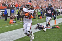 Cleveland Browns running back Kareem Hunt (27) scores a 29-yard touchdown during the second half of an NFL football game against the Chicago Bears, Sunday, Sept. 26, 2021, in Cleveland. (AP Photo/David Richard)
