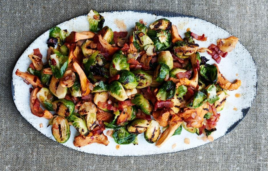 "Letting the mushrooms cook undisturbed is the best way to get a good sear. Resist the urge to stir until they're browned. <a href=""https://www.bonappetit.com/recipe/grilled-brussels-sprouts-with-chanterelles?mbid=synd_yahoo_rss"" rel=""nofollow noopener"" target=""_blank"" data-ylk=""slk:See recipe."" class=""link rapid-noclick-resp"">See recipe.</a>"