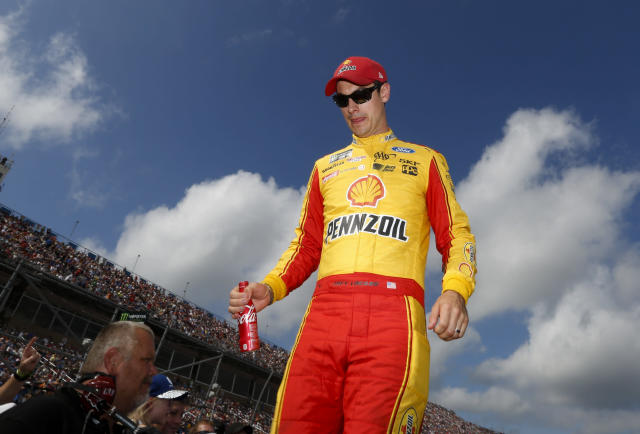 "<a class=""link rapid-noclick-resp"" href=""/nascar/sprint/drivers/1542/"" data-ylk=""slk:Joey Logano"">Joey Logano</a> walks off the stage at Talladega Superspeedway, Sunday, Oct. 15, 2017, in Talladega, Ala. (AP Photo/Brynn Anderson)"