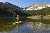 """<p>Enjoy the sun shining on your skin, the sound of birds chirping, and the peaceful lull of the water beneath you. <a href=""""https://www.popsugar.com/fitness/try-paddleboarding-for-total-body-cardio-workout-47632944"""" class=""""link rapid-noclick-resp"""" rel=""""nofollow noopener"""" target=""""_blank"""" data-ylk=""""slk:Stand-up paddleboarding"""">Stand-up paddleboarding</a> will challenge your balance and help improve your core strength, but it's so leisurely that you'll forget it's exercise (until the next day).</p>"""