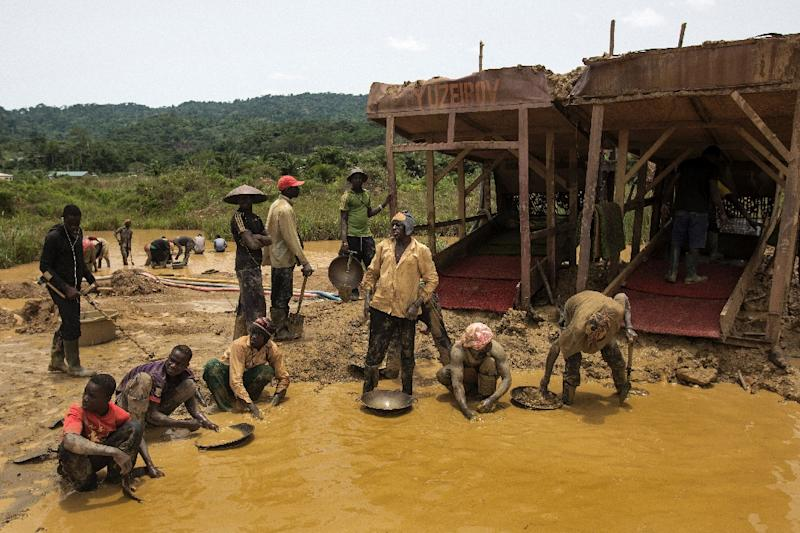 A group of galamseyers, illegal gold panners, working in the Kibi area of Ghana, long known for its bountiful gold reserves