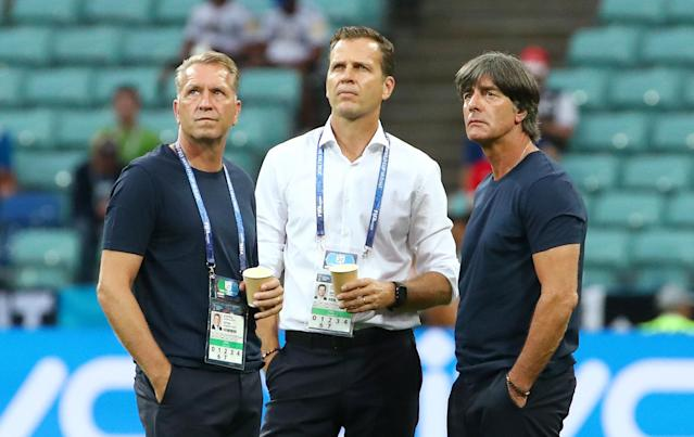 Soccer Football - World Cup - Group F - Germany vs Sweden - Fisht Stadium, Sochi, Russia - June 23, 2018 Germany coach Joachim Low, goalkeeping coach Andreas Koepke and manager Oliver Bierhoff before the match REUTERS/Michael Dalder