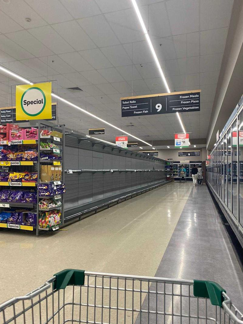 Picture of Berala Woolworths, where the toilet paper aisle is completely empty