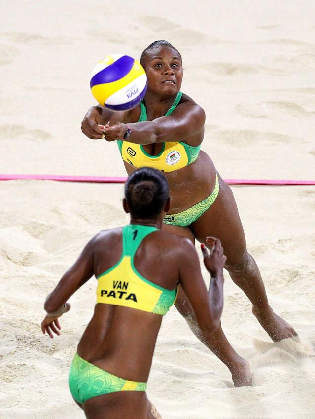 Beach Volleyball - Gold Coast 2018 Commonwealth Games - Women's Bronze Match - Cyprus v Vanuatu - Coolangatta Beachfront - Gold Coast, Australia - April 12, 2018. Miller Pata and Linline Matauata of Vanuatu in action. REUTERS/Athit Perawongmetha