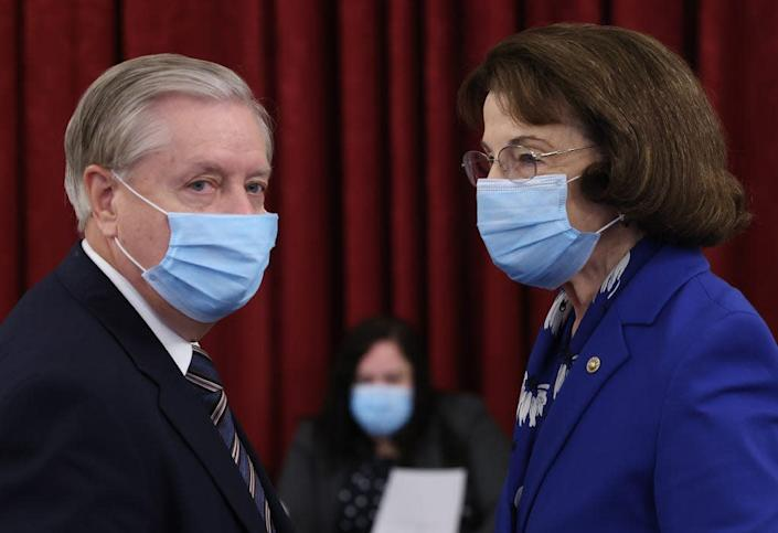 Sen. Lindsey Graham (L) (R-SC), Chairman of the Senate Judiciary Committee, speaks to ranking member Sen. Dianne Feinstein (R) (D-CA) prior to a committee hearing on September 24, 2020 in Washington, D.C.
