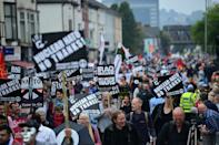 Demonstrators take part in a protest march on the sidelines of the NATO Summit in Newport, Wales, on September 4, 2014