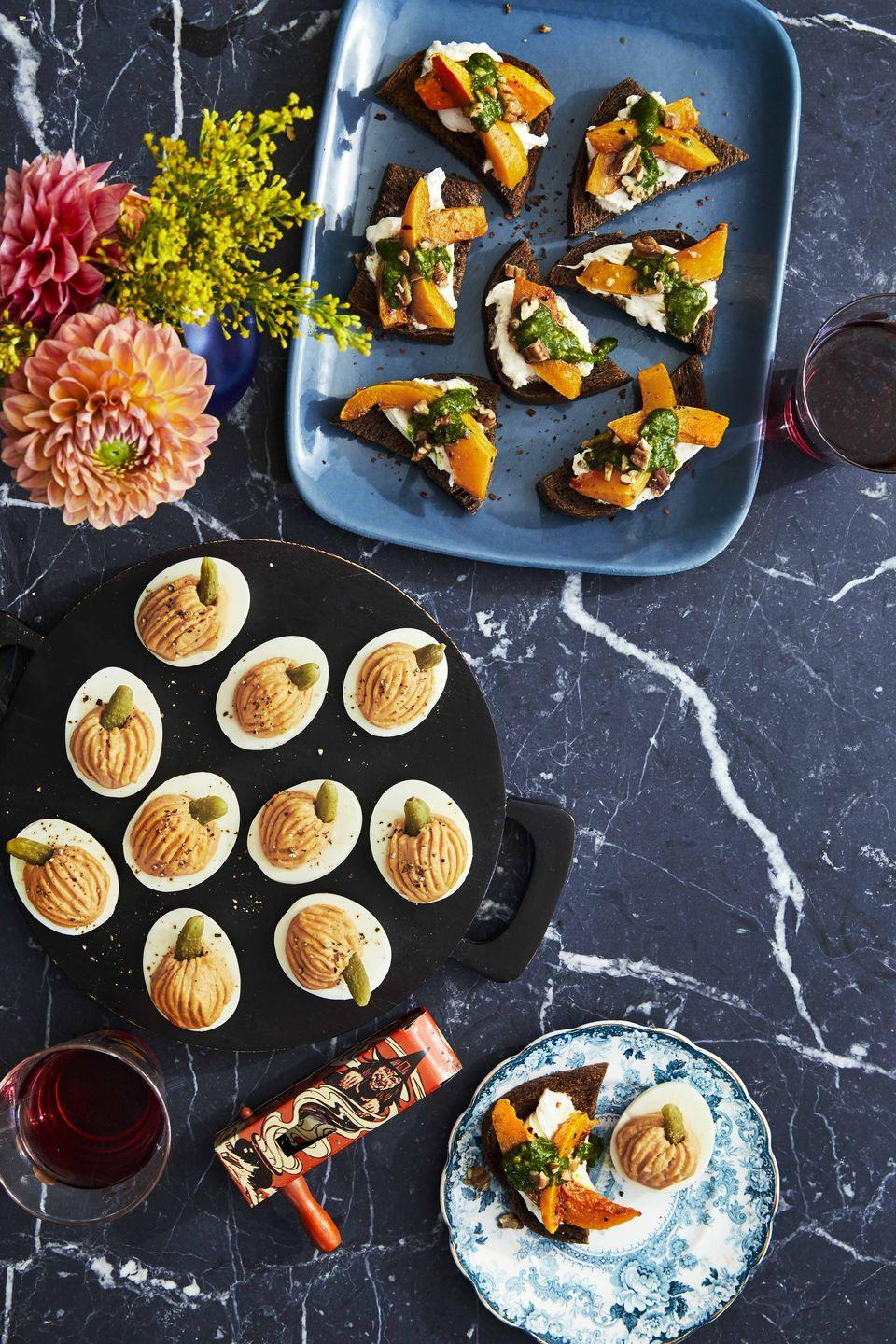 """<p>Make this simple fall-flavored recipe as a hors d'oeuvre, an appetizer, or an afternoon snack.</p><p><strong><a href=""""https://www.countryliving.com/food-drinks/a33943615/pumpkin-and-pesto-crostini/"""" rel=""""nofollow noopener"""" target=""""_blank"""" data-ylk=""""slk:Get the recipe"""" class=""""link rapid-noclick-resp"""">Get the recipe</a>.</strong></p><p><strong><a class=""""link rapid-noclick-resp"""" href=""""https://www.amazon.com/Nutribullet-Superfood-Nutrition-Extractor-NBR-0601/dp/B07CTBHQZK/?tag=syn-yahoo-20&ascsubtag=%5Bartid%7C10050.g.619%5Bsrc%7Cyahoo-us"""" rel=""""nofollow noopener"""" target=""""_blank"""" data-ylk=""""slk:SHOP BLENDERS"""">SHOP BLENDERS</a><br></strong></p>"""
