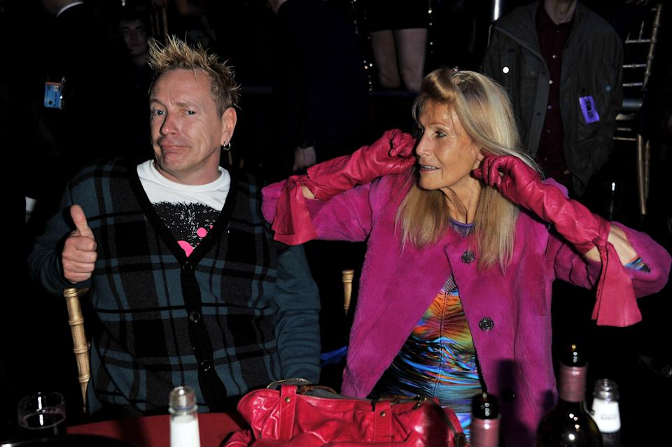 LONDON, ENGLAND - FEBRUARY 23:  John Lydon and Nora Forster share a joke at their table at the NME Awards 2011 at Brixton Academy on February 23, 2011 in London, England.  (Photo by Jon Furniss/WireImage)