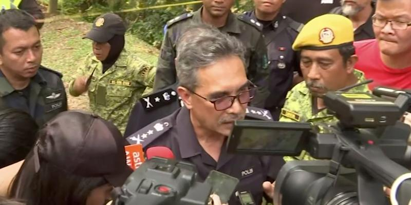 Negeri Sembilan state police chief Mohamad Mat Yusop, center, speaks to media in Pantai, Malaysia Tuesday, Aug. 13, 2019. Malaysian rescuers on Tuesday found the body of a Caucasian female in the forest surrounding a nature resort where a 15-year-old London girl was reported missing more than a we