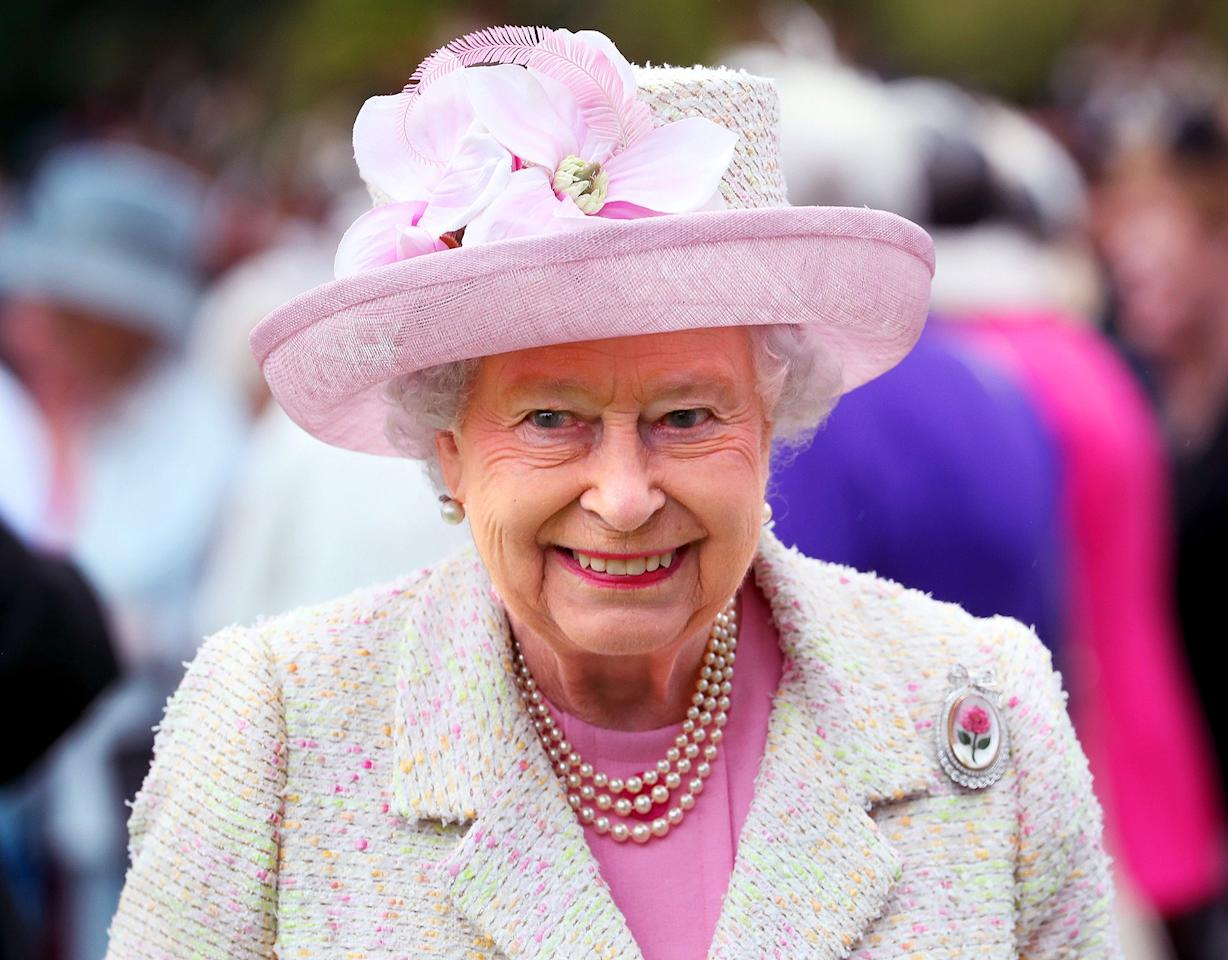 It may have been America's birthday, but the Queen's gorgeous hat took the cake at her annual garden party at Holyroodhouse on July 4.