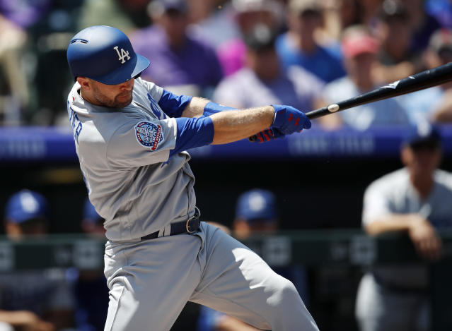 Los Angeles Dodgers' Brian Dozier singles off Colorado Rockies starting pitcher Chad Bettis in the first inning of a baseball game Sunday, Aug. 12, 2018, in Denver. (AP Photo/David Zalubowski)