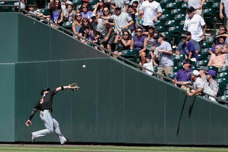 Jun 23, 2018; Denver, CO, USA; Miami Marlins left fielder J.B. Shuck (3) makes a catch for an out in the eighth inning against the Colorado Rockies at Coors Field. Mandatory Credit: Isaiah J. Downing-USA TODAY Sports