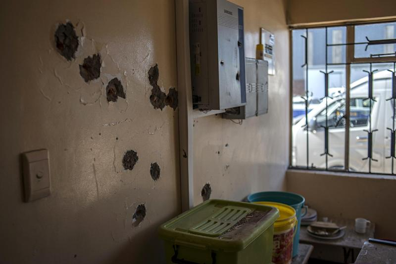 Bullet holes cover a wall at the Hamabote police station in Maseru on September 2, 2014 a few days after it was attacked (AFP Photo/Mujahid Safodien)