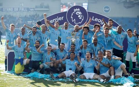 Manchester City celebrate winning the title - Credit: Reuters