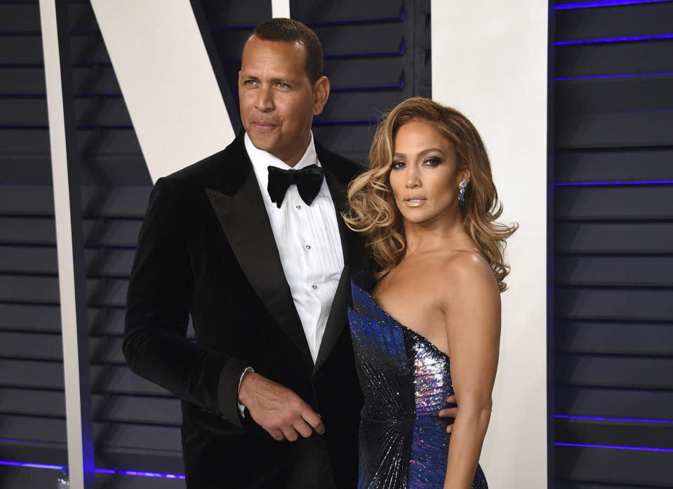 "FILE - Alex Rodriguez, left, and Jennifer Lopez arrive at the Vanity Fair Oscar Party in Beverly Hills, Calif. on Feb. 24, 2019. Lopez and Rodriguez told the ""Today"" show Thursday, April 15,2021, in a joint statement that they are calling off their two-year engagement. (Photo by Evan Agostini/Invision/AP, File)"