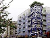 """<b>7. Epi Apartments; Seattle, Washington</b> We're all for occasional quirkiness, but in this case we're not sure how adding a bunch of almost intimidating, sharp-looking metal shapes onto an otherwise bland building enhances it. The building's website boldly refers to the structure as """"The center of the center of the universe."""""""