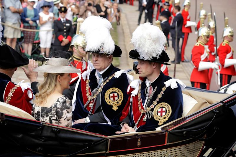 Prince William, right, Prince Andrew, second right, Prince Edward, left, and Edward's wife Sophie Countess of Wessex leave in a carriage (AP)