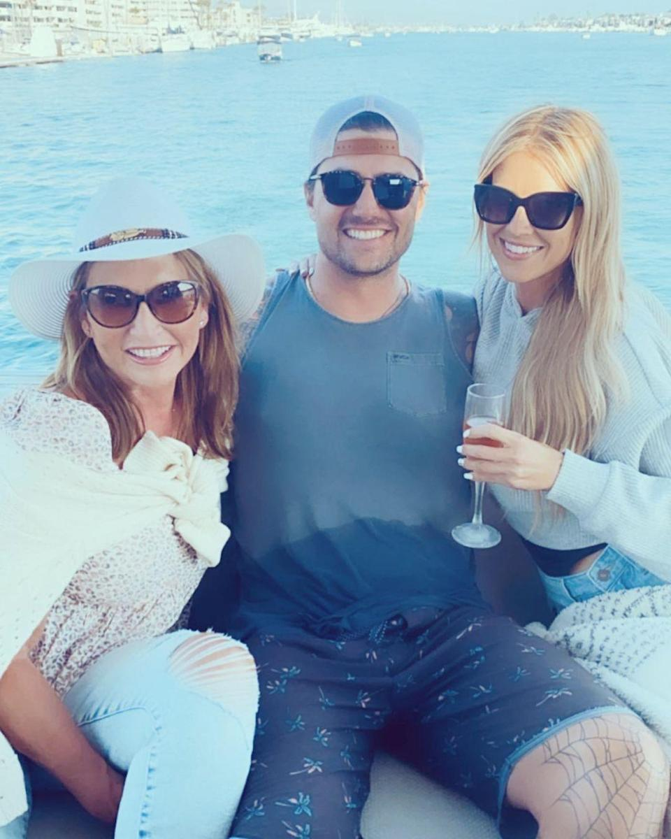 """<p>""""Boat day with friends, my man and his pretty mama. ❤️ ☀️,"""" Haack captioned a photo of the three happily smiling for the camera.</p>"""