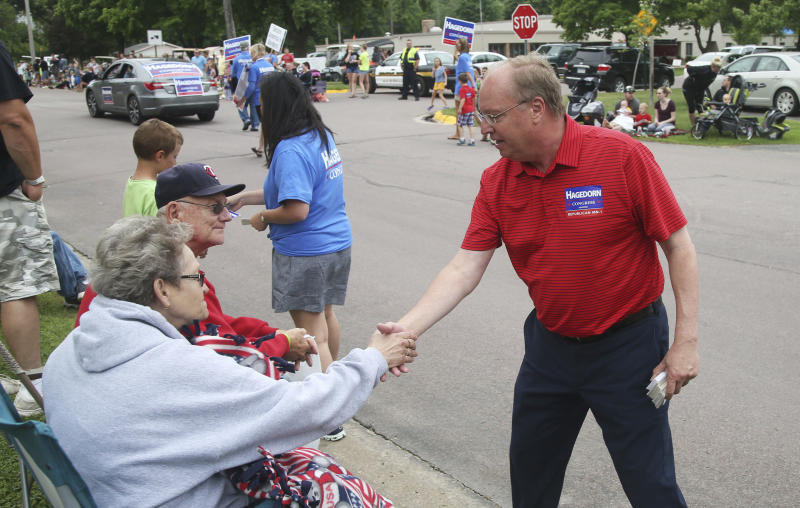 In this June 10, 2018 photo, Minnesota 1st District congressional candidate Jim Hagedorn works a parade in Waterville, Minn. Waterville's 54th annual Bullhead Days parade included Republican Hagedorn and Democrat Dan Feehan, candidates who came to shake as many hands as they could in the open seat race which promises to be one of the most closely watched races in the country. (AP Photo/Jim Mone)