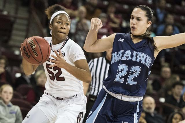 FILE - In this Nov. 21, 2016, file photo, South Carolina guard Tyasha Harris (52) drives to the hoop against Maine guard Blanca Millan (22) during the first half of an NCAA college basketball game in Columbia, S.C. South Carolina players Mikiah Herbert Harrigan and Harris went sixth and seventh to Minnesota and Dallas in the first round of the WNBA Draft, Friday, April 17, 2020. (AP Photo/Sean Rayford, File)