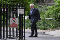 """Britain's Prime Minister Boris Johnson walks to 10 Downing Street after his press conference, in London, Monday, June 14, 2021. Johnson has confirmed that the next planned relaxation of coronavirus restrictions in England will be delayed by four weeks until July 19 as a result of the spread of the delta variant. In a press briefing Monday, Johnson said he is """"confident that we won't need more than four weeks"""" as millions more people get fully vaccinated against the virus, which could save thousands of lives. (AP Photo/Alberto Pezzali)"""