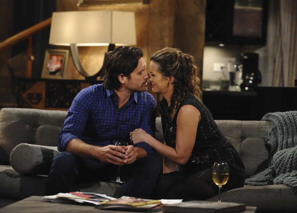 "This 2017 image released by CBS shows Joshua Morrow, left, and Melissa Claire Egan in a scene from the daytime drama ""The Young and the Restless."" The series is scheduled to go back into production next week after halting due to the coronavirus epidemic. (Johnny Vy/CBS via AP)"