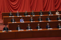Delegates applaud as Chinese President Xi Jinping, left, delivers a speech at an event commemorating the 110th anniversary of Xinhai Revolution at the Great Hall of the People in Beijing, Saturday, Oct. 9, 2021. (AP Photo/Andy Wong)