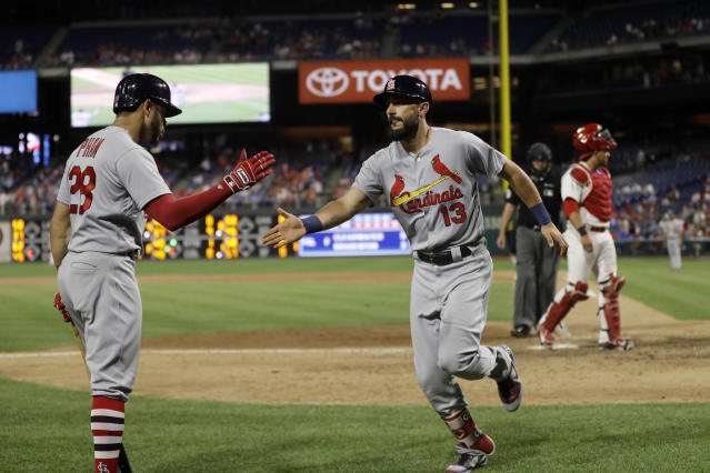 St. Louis Cardinals' Matt Carpenter, center, celebrates with Tommy Pham, left, after Carpenter's go-ahead home run off Philadelphia Phillies relief pitcher Seranthony Dominguez during the ninth inning of a baseball game, Tuesday, June 19, 2018, in Philadelphia. St. Louis won 7-6. (AP Photo/Matt Slocum)