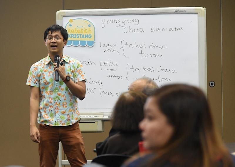 The students learning Kristang -- spoken in parts of the Malaysian city of Malacca as well as Singapore -- attend Kevin Martens Wong's classes three times a week (AFP Photo/ROSLAN RAHMAN)