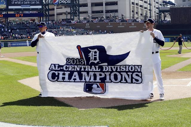 Detroit Tigers first baseman Miguel Cabrera, left, and pitcher Max Scherzer hold the AL Central Division Champions banner before the start of the baseball game against the Kansas City Royals in Detroit, Monday, March 31, 2014. (AP Photo/Carlos Osorio)