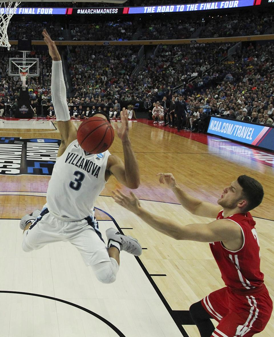 <p>Villanova guard Josh Hart (3) loses control of the ball while driving to the basket against Wisconsin guard Zak Showalter (3) during the first half of a second-round men's college basketball game in the NCAA Tournament, Saturday, March 18, 2017, in Buffalo, N.Y. (AP Photo/Bill Wippert) </p>