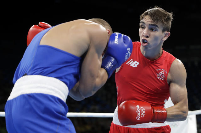 FILE - In this Aug. 16, 2016, file photo, Ireland's Michael John Conlan, right, fights Russia's Vladimir Nikitin during a men's bantamweight 56-kg quarterfinals boxing match at the 2016 Summer Olympics in Rio de Janeiro, Brazil. Conlan now sees positives in his controversial loss in the 2016 Olympics, believing it was a catalyst for change in amateur boxing. But he still wants revenge and he gets his chance when he faces Vladimir Nikitin on Saturday, Dec. 16, 2019, at Madison Square Garden. (AP Photo/Jae C. Hong, File)