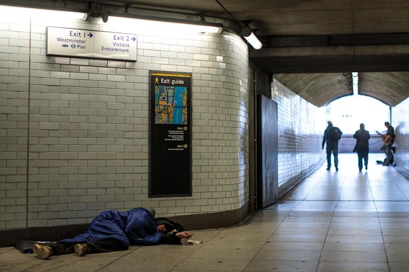 A homeless man sleeps in Westminster station.  (Photo: Jack Taylor via Getty Images)