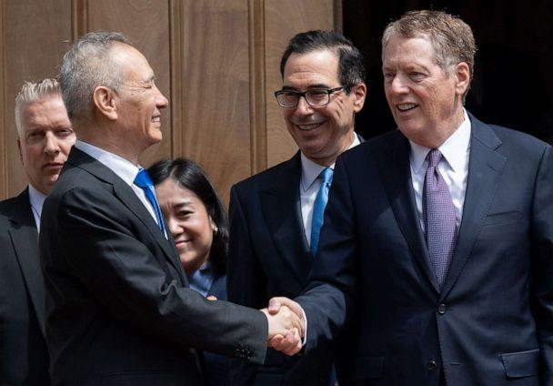 PHOTO: Chinese Vice Premier Liu He (L) shakes hands with US Trade Representative Robert Lighthizer (R) alongside US Treasury Secretary Steven Mnuchin (C) after trade negotiations in Washington, DC, May 10, 2019. (Saul Loeb/AFP/Getty Images, FILE)