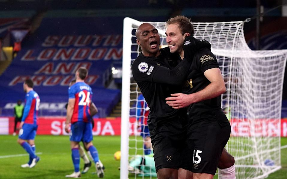 West Ham United's Craig Dawson (right) celebrates scoring their side's third goal of the game with Angelo Ogbonna during the Premier League - PA