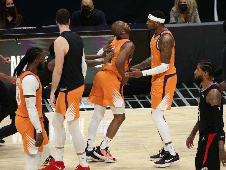 Chris Paul is shoved by Patrick Beverley as tempers flare in Phoenix's clash with the Los Angeles Clippers