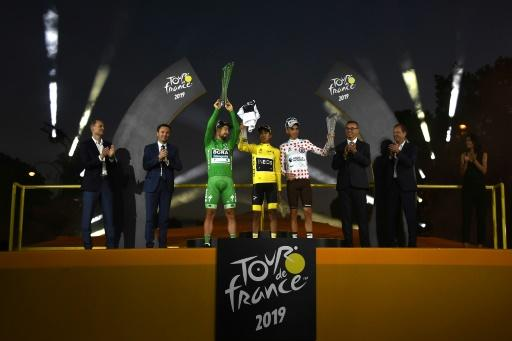 Peter Sagan in the sprinter's green jersey alongside the 2019 champion Egan Bernal in yellow and king of the mountains Romain Bardet in the polka dot jersey