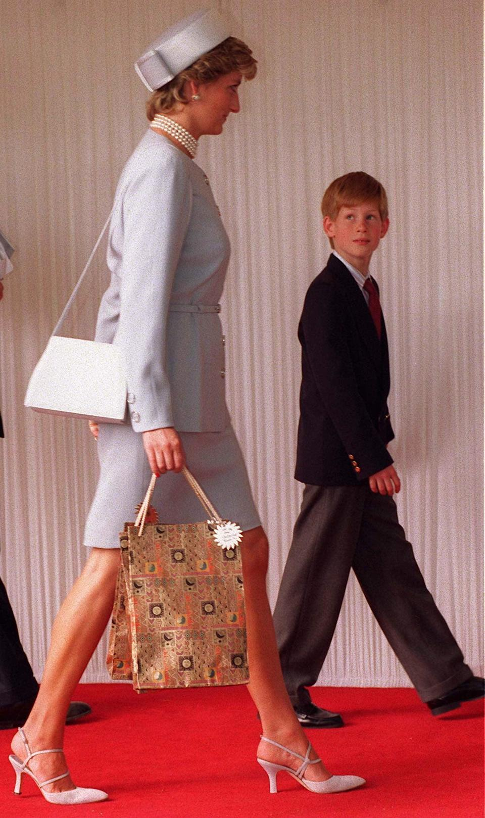 <p>Diana also owned this more structural version, which she paired with a powder-blue suit and pumps in 1995 (we see you over there, Prince Harry!).</p>