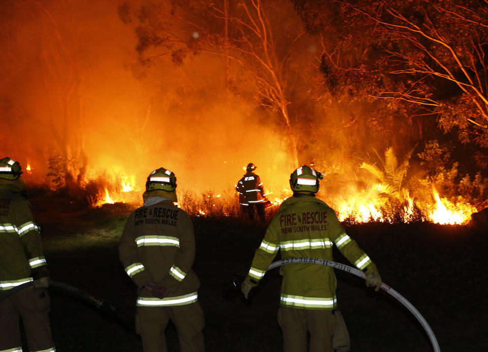 Fire crews undertake back burning near Railway Crescent, Belmont, Lake Macquarie, NSW on Thursday. NSW Rural Fire Service has issued an emergency warning for an out-of-control bushfire burning in Lake Macquarie. Source: AAP Image/Darren Pateman