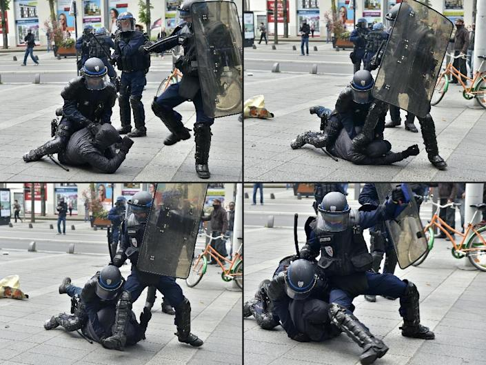 French riot police arrest a protester during a demonstration against proposed labour reforms in Nantes (AFP Photo/Loic Venance)