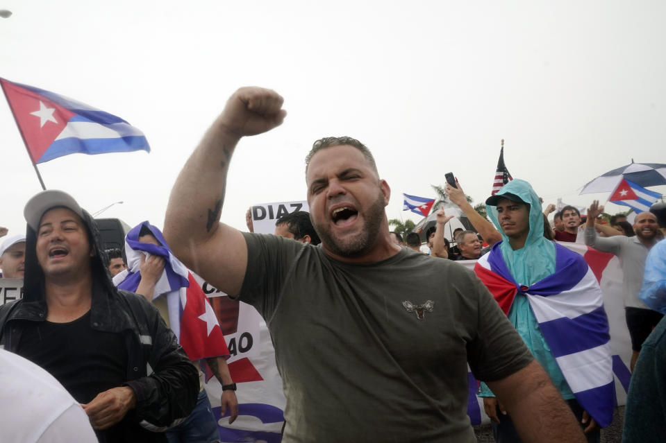 Demonstrators walk on both lanes of the Palmetto Expressway, Tuesday, July 13, 2021, in Miami. The demonstrators, many of them Cuban exiles, expressed support for Cubans, who had taken to the streets of several communities around the communist nation on Sunday to air grievances over poor economic conditions, among other complaints. (AP Photo/Marta Lavandier)