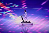 """<p>Japanese boxer Arisa Tsubata ran on a treadmill to symbolize how many athletes had to <a href=""""https://www.popsugar.com/fitness/arisa-tsubata-treadmill-opening-ceremony-2021-olympics-48431916/"""" class=""""link rapid-noclick-resp"""" rel=""""nofollow noopener"""" target=""""_blank"""" data-ylk=""""slk:train in isolation"""">train in isolation</a>, but stayed connected through their collective passion to compete.</p>"""