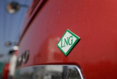 A logo of liquefied natural gas (LNG) is pictured on a LNG truck outside a heavy-duty truck shop in Yutian county, China's Hebei province September 29, 2017. REUTERS/Jason Lee